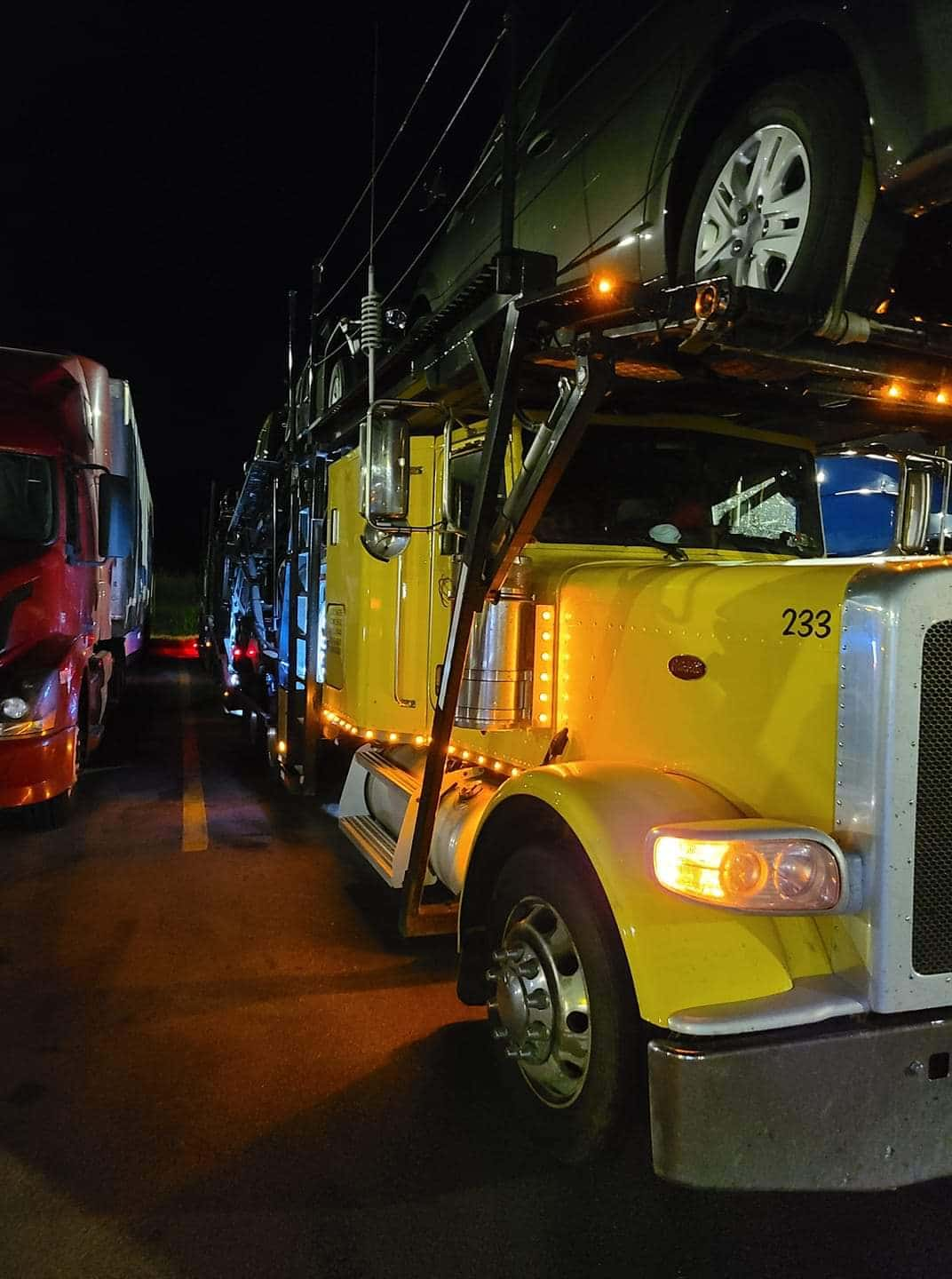 parked car carrier with lights on