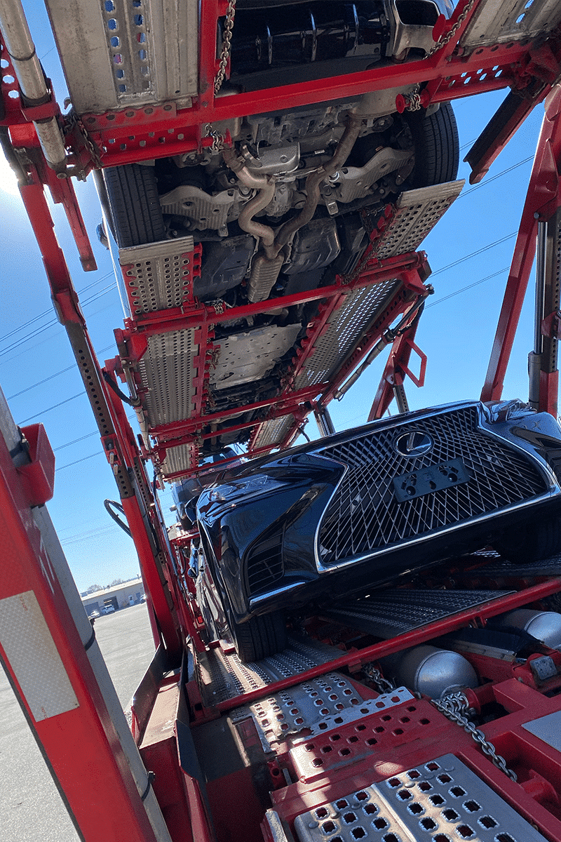 bottom rack of car carrier trailer looking up