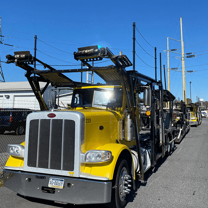 car carrier sitting in truck lot