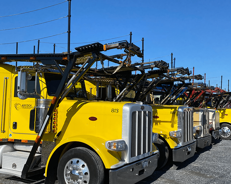 closer car carriers line up in a row